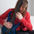 Young guitarist playing guitar — Stock Photo
