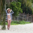 Стоковое фото: Beautiful woman relaxing on tropical beach