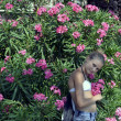 The girl in flowers - Foto Stock