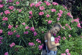 The girl in flowers — Stock Photo