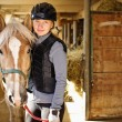 Girl with horse — Stock Photo #11552105