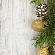 Christmas background with ornaments on branch — Stockfoto