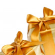 Two golden wrapped gift boxes — Stock Photo