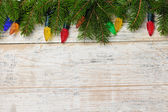 Christmas background with lights on branches — Stock Photo