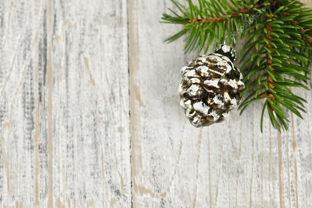 Golden Christmas pine cone on tree branch with wooden background  Stock Photo #16628153