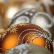 Gold Christmas ornaments closeup — Stock Photo