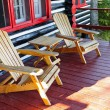 Log cabin porch with chairs — Stock Photo