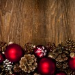 Photo: Wood background with Christmas ornaments