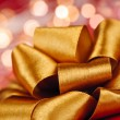 Stock Photo: Gold gift bow with festive lights