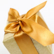 Golden wrapped gift box — Stock Photo