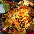 Nacho basket with cheese - Stock Photo