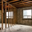 Home interior gutted for renovation - Stock Photo