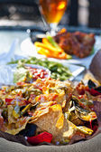 Nacho plate and appetizers — Stock Photo