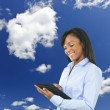 Happy woman with tablet computer and clouds — Stock Photo #16941771