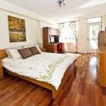 Bedroom interior with hardwood floor — Stock Photo