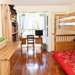 Bedroom interior with hardwood floor - Stock Photo