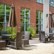 Tables and chairs on outdoor patio — Stock Photo