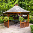 Gazebo in garden - Stock Photo