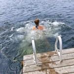 Teenage girl swimming in lake — Stock Photo