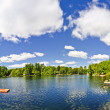 Cottage lake with diving platform and dock — Stock Photo #16942117