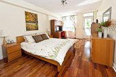 Bedroom interior with hardwood floor — Stok fotoğraf