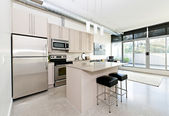 Modern condo kitchen and living room — Stockfoto