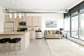 Modern condo kitchen and living room — Stock Photo