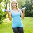 Womexercising with dumbbells — Stock Photo #27799103