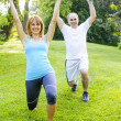 Personal trainer with client exercising outdoors — Stock Photo