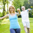 Personal trainer with client exercising in park — Stock Photo