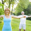 Personal trainer with client exercising outside — Stock Photo #27799181