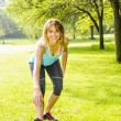 Stock Photo: Woman stretching in park