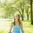 Woman in lotus yoga pose outside — Stock Photo