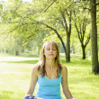 Woman in lotus yoga pose outside — Stock Photo #27799569