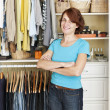 Smiling woman near closet — Stock Photo #27799789