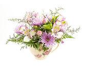 Flower arrangement on white — Stock Photo