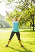 Woman exercising in park — Stock Photo