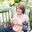 Woman relaxing in backyard — Stock Photo #27908675