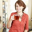 Smiling woman with tea at home — Stock Photo