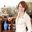 Woman with antique collection — Foto de Stock