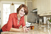 Woman using cell phone at home — Stock Photo