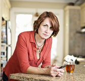 Concerned mature woman in kitchen — Stock Photo