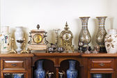 Antique vases and clocks — Stock Photo