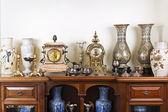 Antique vases and clocks — Stock Photo