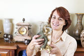 Woman polishing antiques — Stock Photo