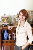 Woman with antique collection — Stock Photo