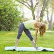 Woman in yoga triangle pose — Stock Photo