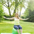 Womon yogbalance ball — Stock Photo #27910607