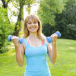 Womexercising with dumbbells — Stock Photo #27910635