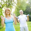 Personal trainer with client exercising — Stock Photo